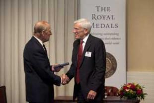 Professor David Milne receiving his medal from HRH The Duke of Edinburgh