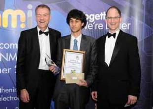 Rares-Mihai Popa receives UKESF scholar award from Derek Boyd, CEO, NMI and Neil Dickins, IC Group