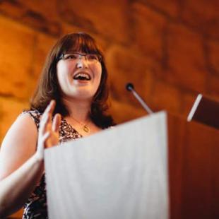 Kathy Bayman talking at lecturn