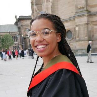 Olivia Sweeney, graduation profile image in front of McEwans Hall