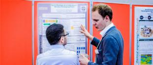 Chemical Engineering student discussing Industrial placement project poster