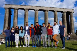 University of Edinburgh students gathered for a group photograph at the top of Calton Hill