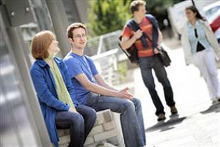 Engineering students sitting outside the AGB Building on King's Buildings Campus, in summer