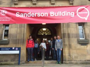 Staff and students gathered under the Sanderson Building entrance, School of Engineering, King's Buildings