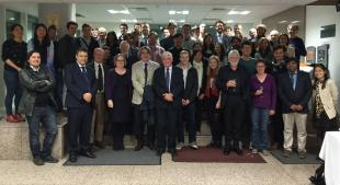Academic and students assembled with Professor Geoff Maitland for a group photograph