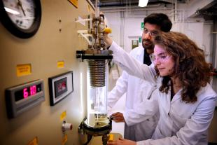 Engineering students in a Chemical Engineering laboratory