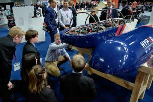 HYPED Hyperloop pod on show with crowd asking questions of Engineering students