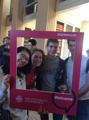 Staff and students pose for group photos with #EdWelcome week selfie frames