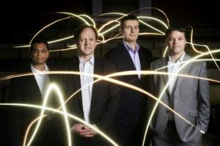 Professor Harald Haas (at second from left) and the pureLiFi team (Photo: Business Wire) Multimedia Gallery URL
