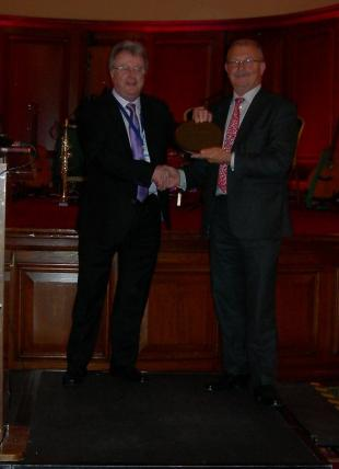 Professor Mike Forde presented with award