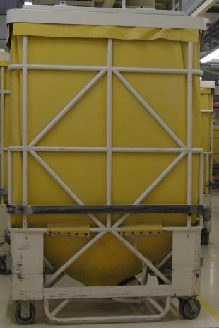 "A typical flexible container for storage and transport of powders, called a ""powder buggy"""