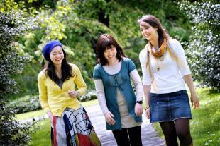 Students in Edinburgh walking through a park