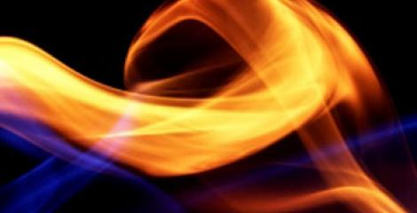 A close up photograph of a flame of fire